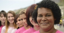 diverse women in pink charity walk